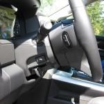 Power-Adjustable Pedals; Audio Controls Behind Steering Wheel