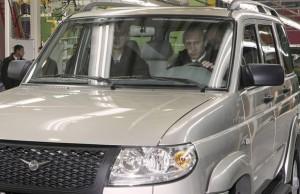 Vladimir Putin behind the wheel of a Sollers vehicle in December 2009 - Reuters file photo