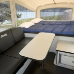 Jeep and Mopar are first in the industry to offer off-road camper trailers.  Campers feature a queen-size bed, sofa with stowable table, built-in aluminum cabinet, 110-volt power supply and a premium canvas enclosure.  For casual campers, the Jeep Trail Edition camper (pictured) is designed to endure trails with its lightweight all-aluminum construction, 32-inch BF Goodrich Mud Terrain tires, 12 inches of ground clearance, trailing-arm suspension, diamond-plated aluminum covering, and available 360-degree axis pintle hitch. The MSRP for the Jeep Trail Edition camper is $9,995.