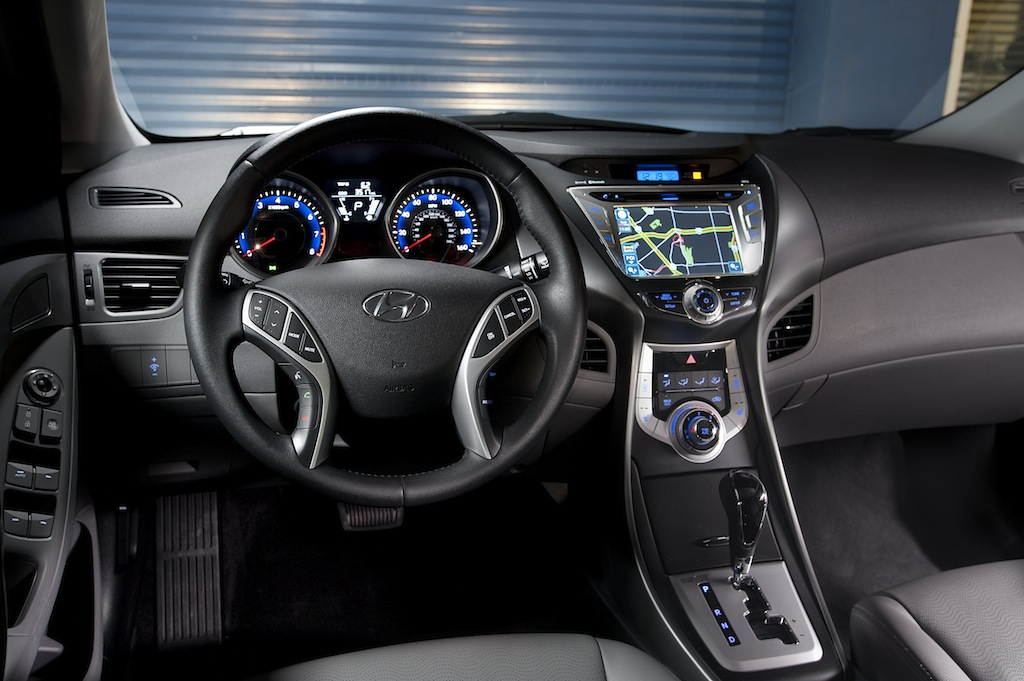 hyundai elantra 2014 interior. blue lighting throughout the interior particularly secondary buttons like hvac stereo nav system clock but main gauges have white electroluminescent hyundai elantra 2014