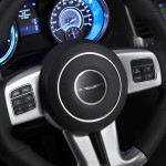 An all-new leather-wrapped, heated, SRT-exclusive steering wheel features a unique rim section with a flattened bottom surface showing the SRT logo. Standard paddle shift controls flank both sides of the new contoured palm rests while all audio and Electronic Vehicle Information Center (EVIC) controls are accessible from the horizontal spokes on the steering wheel.